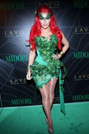 Kim Kardashian as Poison Ivy, 2011. Photo via Getty Images