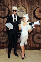 Josh Duhammel and Fergie as Karl Lagerfeld and Choupette, 2015. Photo via Getty Images